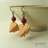 Orange pinstripe humbugs with red beads on bronze hypo-allergenic niobium hooks