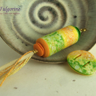Yellow green and orange polymer clay pendant and buckle connector