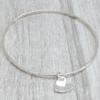 Silver heart on hammered skinny silver bangle