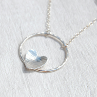 Silver heart and hammered circle necklace