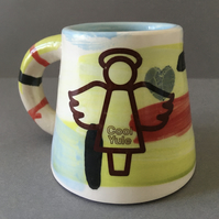 "Handmade Festive cup with angel ""Cool Yule"" decoration."
