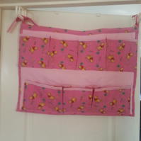 Multi pocket multi purpose cot or bedroom organiser