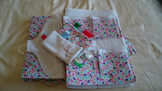 Cot organiser, nappy stacker and cuddle cloth