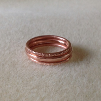 Solid copper textured triple stacking rings.