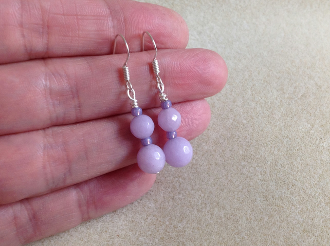 Sterling silver and faceted lavender jade earrings.