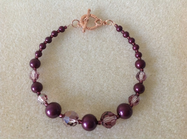 Blackberry maroon pearl and crystal rose gold bracelet.