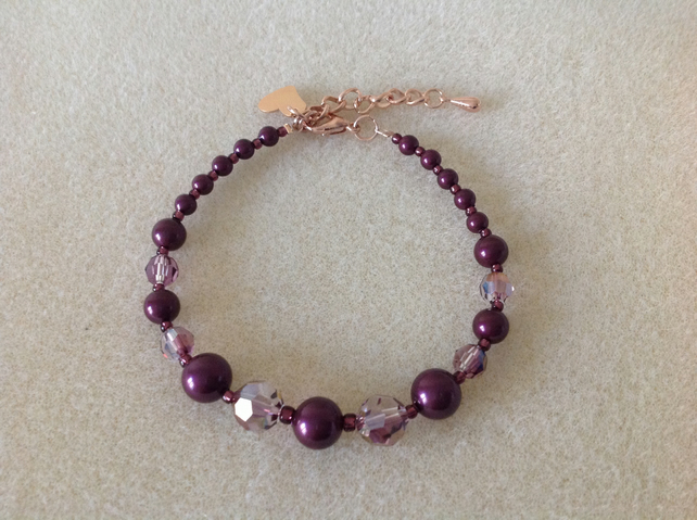 Blackberry maroon pearl and crystal rose gold heart charm bracelet.