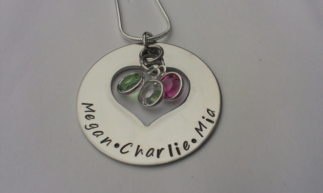 Hand stamped round pendant with heart cutout