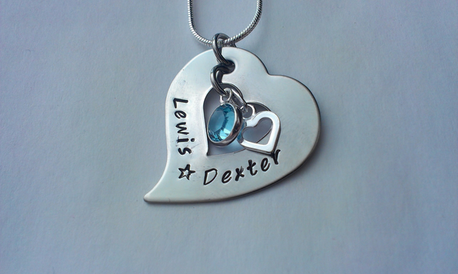 Hand stamped tilted heart washer necklace with sterling silver charm