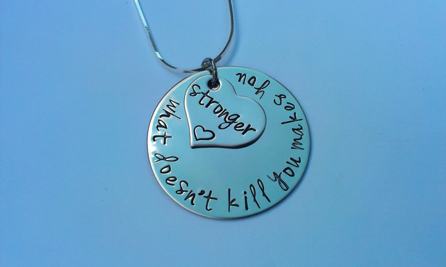 What doesn't kill you makes you stronger Hand Stamped necklace