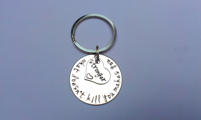 What doesn't kill you makes you stronger Hand Stamped keyring