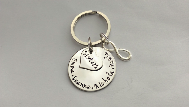 Hand stamped personalised sisters name keyring with inifinity charm