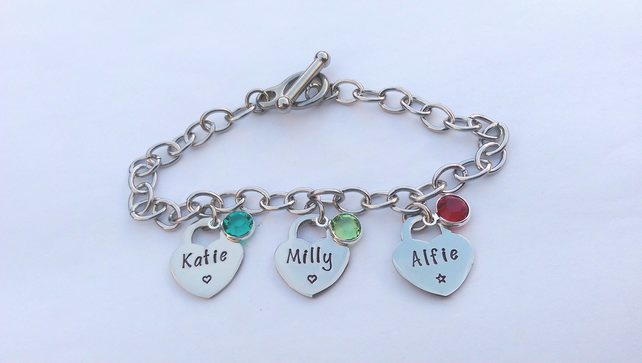 Hand stamped personalised charm bracelet with tiffany style heart charms