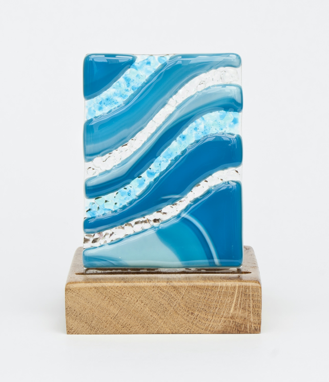 A Fused Glass Panel with a Wavy Teal Design set in an Oak Tealight Holder