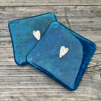 A pair of Dark Teal Fused Glass Coasters  with Brass Heart