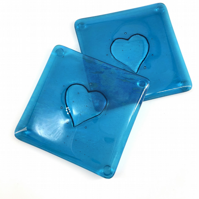 A Gorgeous pair of Teal Fused Glass Coasters with an embossed heart
