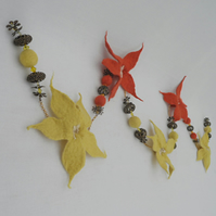 Five flower felted garland, yellow and orange