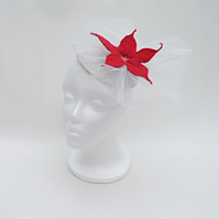 Cream fascinator with red felt flower