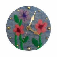 Small clock with felted face in floral design