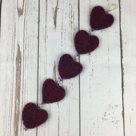 String of hearts, needle felted and beaded, purple