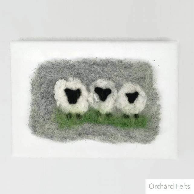 Needle felted picture, three sheep, felted on canvas
