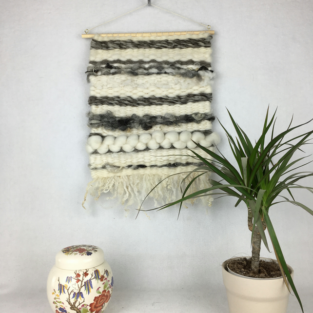 Wall hanging, peg woven in natural fibres