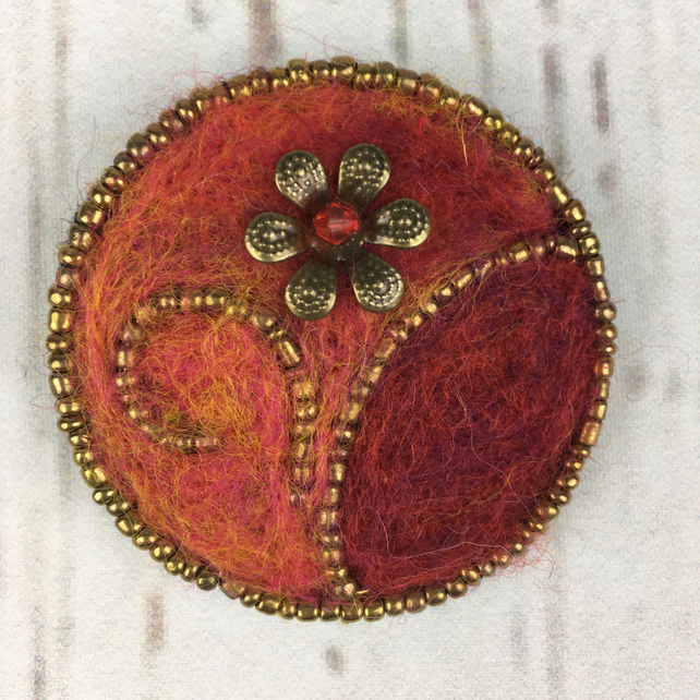 Beaded floral brooch with needle felting in red and orange