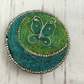Butterfly brooch, needle felted in green and blue with silver beading
