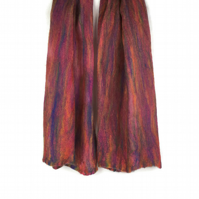 Lightweight nuno felted merino wool scarf in rainbow colours on pink