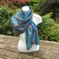 Merino wool on silk nuno felted scarf, rainbow colours on turquoise base