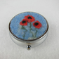Pill box with felted poppy decoration, circular