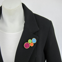 Bright multicoloured brass ring brooch