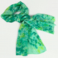Hand dyed crepe de chine silk scarf in green and yellow with circular pattern