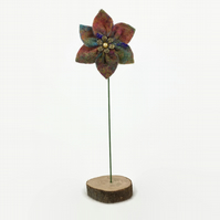 Felted flower decoration, single multicoloured flower on wooden base