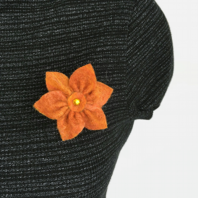 Felt flower brooch in shades of orange