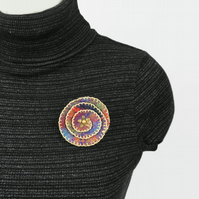 Multicoloured spiral felt flower brooch with gold detail