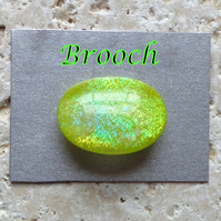 Dichroic lime green fused glass cabochon brooch