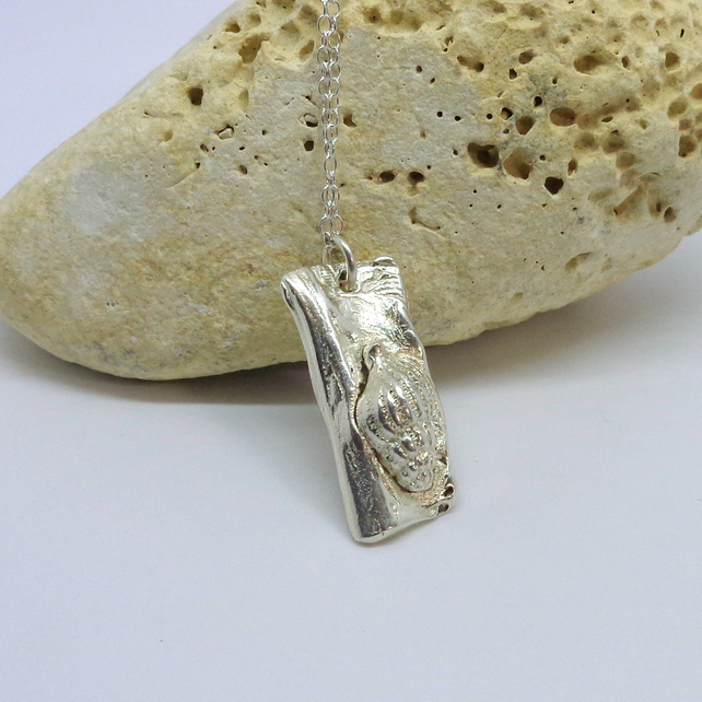 Silver sea shell set on driftwood pendant