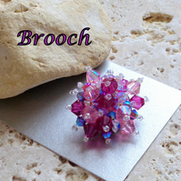 Swarovski crystal starburst brooch in shades of pink