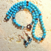 Turquoise beads with copper set