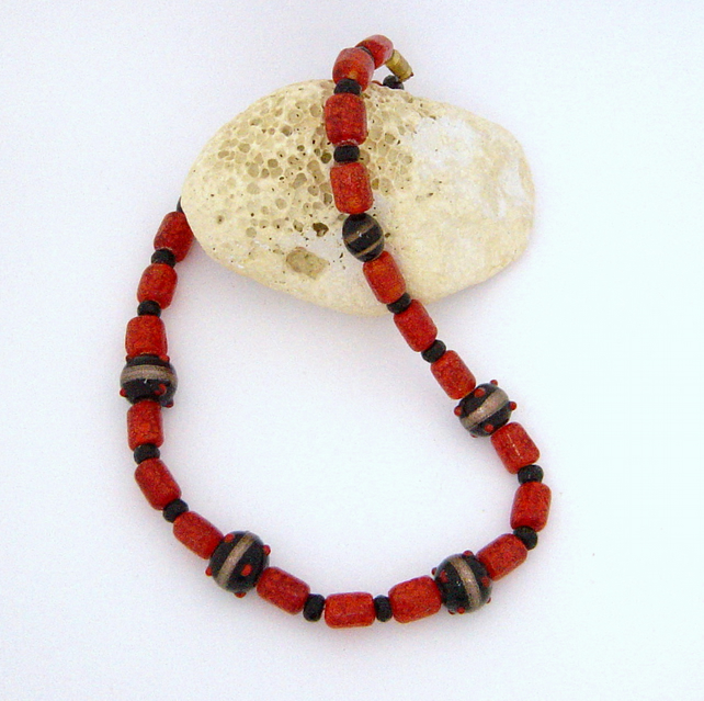 Glass bead necklace in red, black & gold