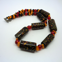 Glass bead ethnic-style necklace in black, orange & red