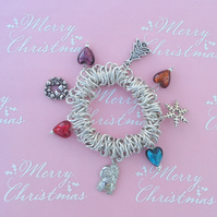 Chistmas charms & hearts on a small, fun, chunky, stretchy bracelet
