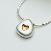 Silver pebble necklace with 24ct gold inlay heart