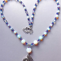 Opal moonstone and Tibetan silver Nautilus shell pendant necklace.