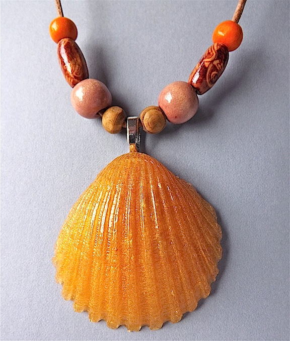 Shell pendant necklace,  anber mica resin and wood beads on leather.