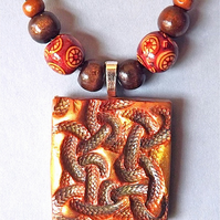 Celtic knot pendant, talisman, necklace, polymer clay and wood beads.