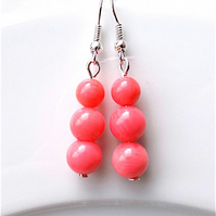 Earrings for pierced ears, sensational pink coral dangle.