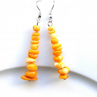 Earrings for pierced ears, sensational yellow coral dangles.