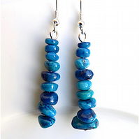 Earrings for pierced ears, sensational blue coral dangles.